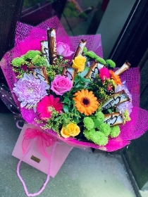 Florists choice hand tied with galaxy chocolates